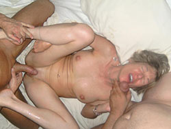 Real mature slut in a hotel threesome