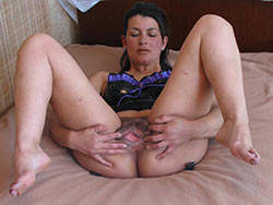 Mature wife spreading nude in bed