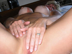Married older woman naked in bed