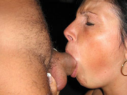 Older wife giving blowjob outdoor
