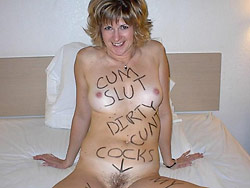 Hot MILF wife naked in bed